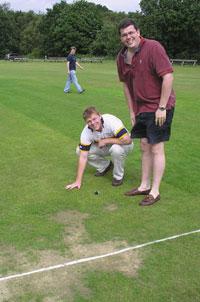 Goss & H-D inspect the pitch
